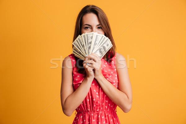 Fiatal boldog vonzó nő vörös ruha rejtőzködik mögött Stock fotó © deandrobot