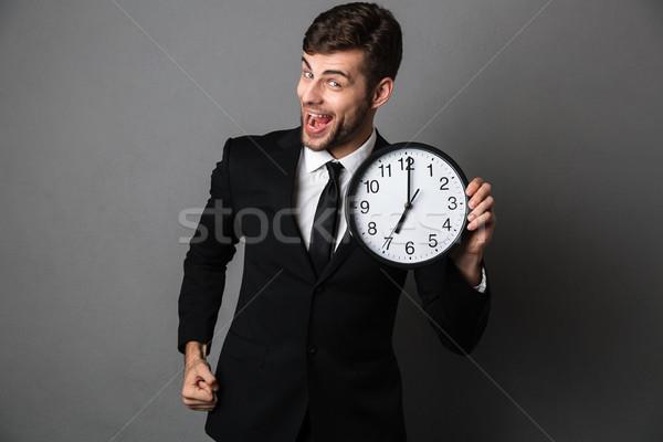 Gelukkig bebaarde man zwart pak klok Stockfoto © deandrobot