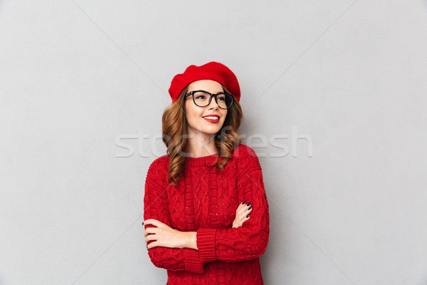 Portrait of a smiling woman dressed in red sweater Stock photo © deandrobot
