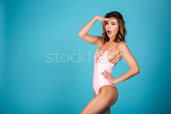 Portrait of a surprised girl dressed in swimsuit Stock photo © deandrobot