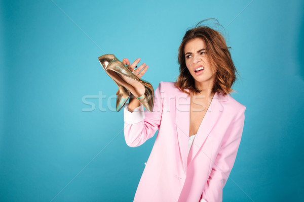 Portrait of a disappointed woman dressed in pink suit Stock photo © deandrobot