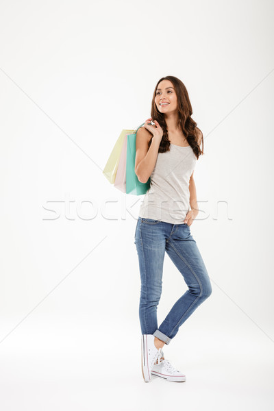 Full-length picture of fancy adult girl looking away and holding Stock photo © deandrobot