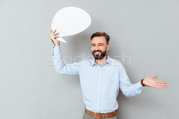 Sorridente barbudo homem negócio roupa Foto stock © deandrobot