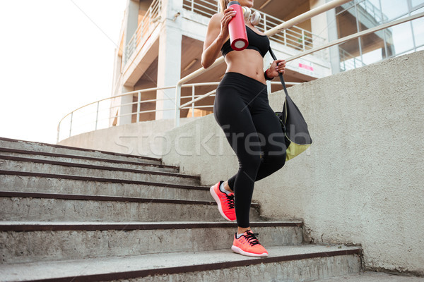Cropped photo of strong young sports woman Stock photo © deandrobot