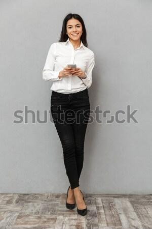 Obraz atrakcyjny business woman formalny nosić Zdjęcia stock © deandrobot