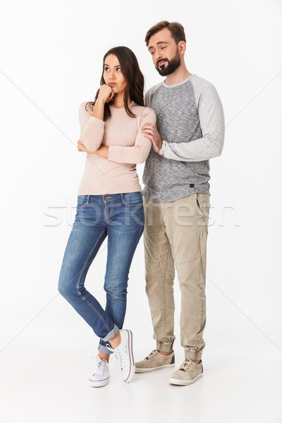 Serious young loving couple quarrel. Stock photo © deandrobot