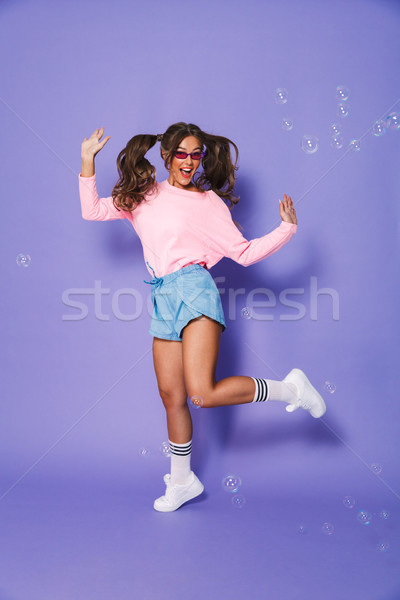 Full length portrait of european teenage girl with two ponytails Stock photo © deandrobot