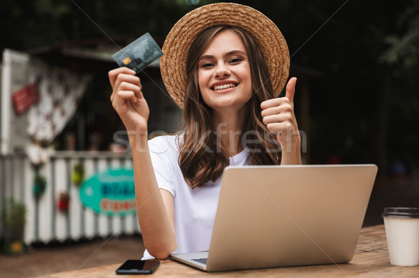 Happy young girl holding plastic credit card Stock photo © deandrobot