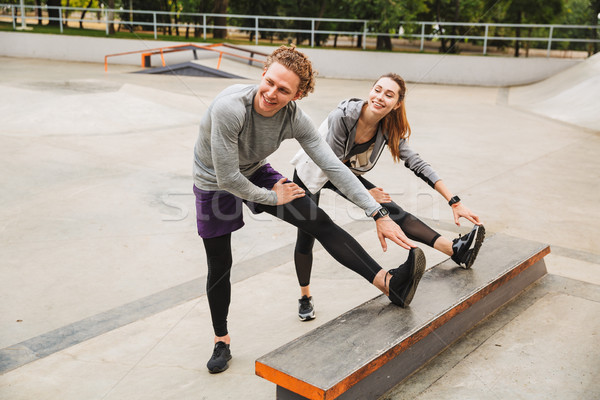 Image of caucasian sporty couple man and woman 20s in sportswear Stock photo © deandrobot