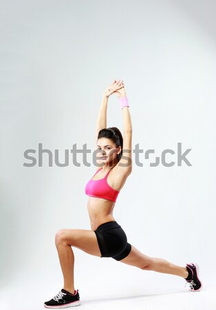 Fiatal boldog sport nő nyújtás lábak Stock fotó © deandrobot