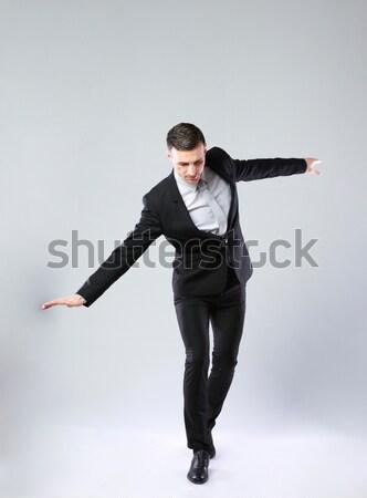 üzletember sétál láthatatlan kötél szürke boldog Stock fotó © deandrobot