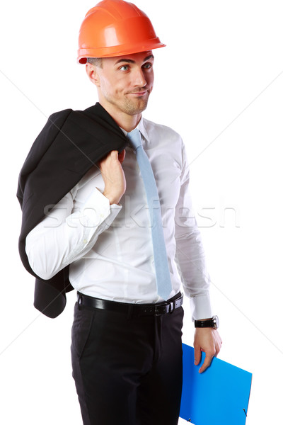 Portrait of a dissatisfied businessman in helmet over white background Stock photo © deandrobot