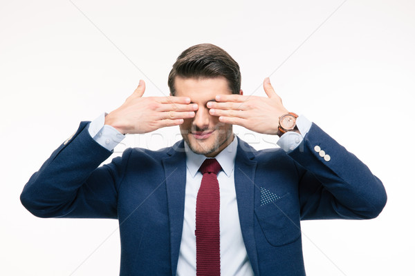 Businessman covering his eyes Stock photo © deandrobot