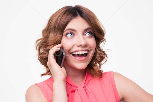 Laughing woman talking on the phone Stock photo © deandrobot
