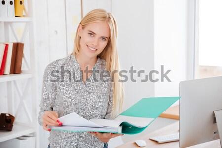 Smiling fashion designer using laptop  Stock photo © deandrobot