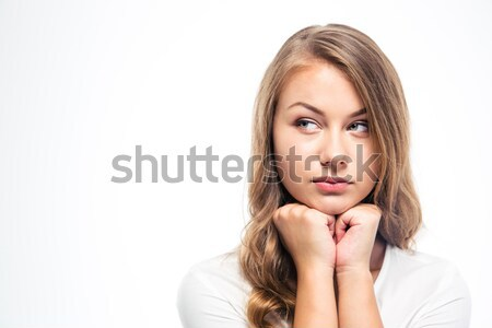 Thoughtful young woman looking away Stock photo © deandrobot