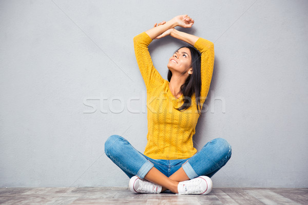 Woman sitting on the floor and looking up  Stock photo © deandrobot