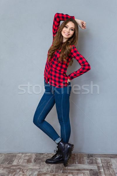 Jungen schöne Mädchen posiert lächelnd positive lockig Stock foto © deandrobot