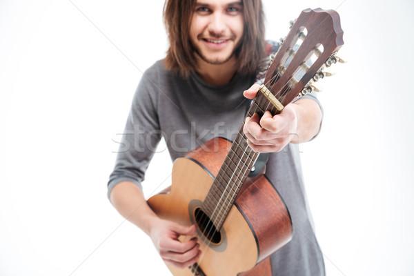 Séduisant souriant jeune homme cheveux longs jouer guitare acoustique Photo stock © deandrobot