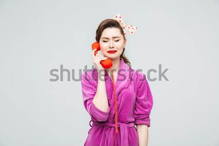 Smiling thoughtful young woman looking away  Stock photo © deandrobot