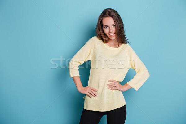 Stock photo: Casual smiling woman looking at camera