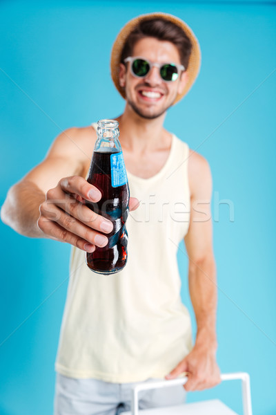 Feliz atraente moço garrafa soda seis Foto stock © deandrobot