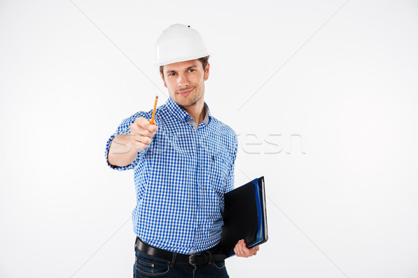 Happy young man architect in hard hat pointing on you Stock photo © deandrobot