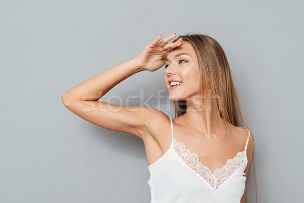 Young attractive girl cover her eyes with hand Stock photo © deandrobot