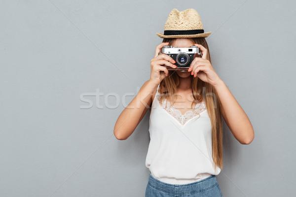 Jovem mulher loira foto câmera seis Foto stock © deandrobot
