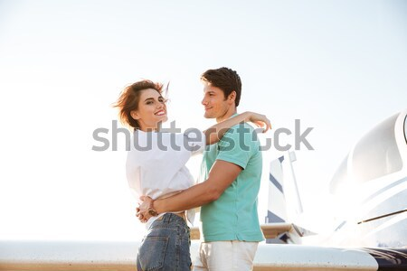 Stock photo: Happy young couple standing and hugging outdoors