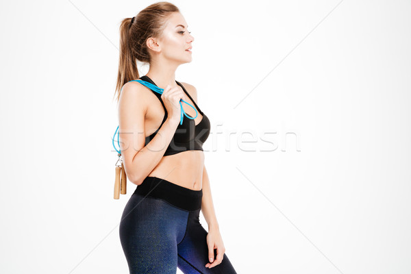 Side view portrait of woman in sportswear with skipping rope Stock photo © deandrobot