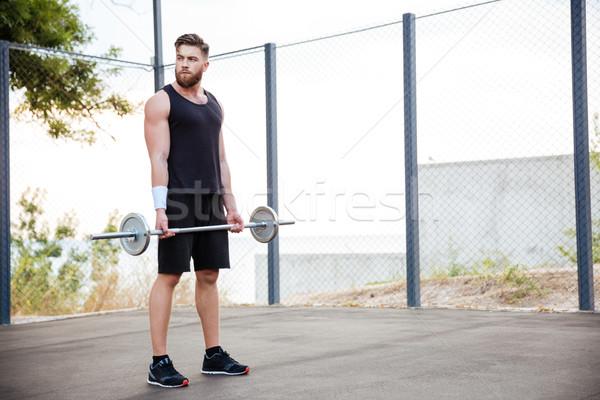 Geconcentreerde jonge man atleet barbell Stockfoto © deandrobot