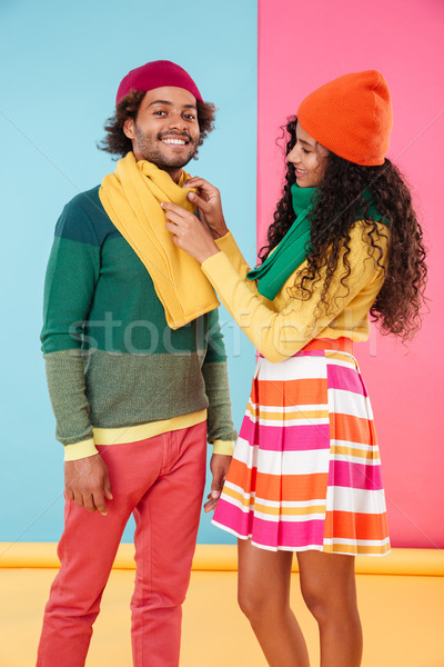 Happy african girl standing and talking care of her boyfriend Stock photo © deandrobot