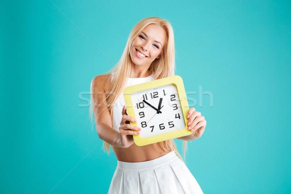 Donna capelli lunghi muro clock Foto d'archivio © deandrobot