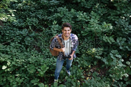 From above image of man with water in forest Stock photo © deandrobot