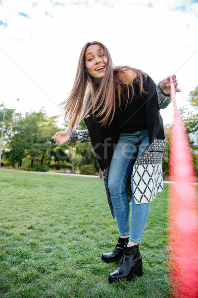 Smiling beautiful young woman looking at her dog and walking Stock photo © deandrobot