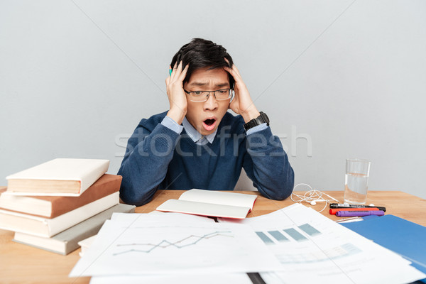 Asian student in panic with notebook Stock photo © deandrobot