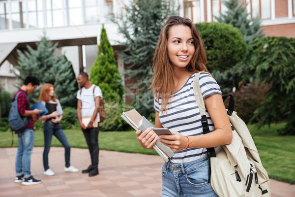 Gelukkig vrouw student rugzak boeken Stockfoto © deandrobot