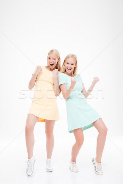 2 女性 勝者 ジェスチャー 白 写真 ストックフォト © deandrobot