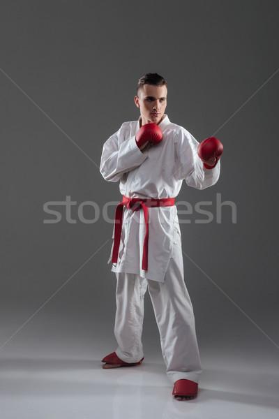 Jóképű fiatalember kimonó gyakorlat karate kép Stock fotó © deandrobot