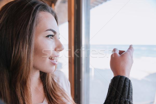 Femme date fenêtre café permanent Photo stock © deandrobot