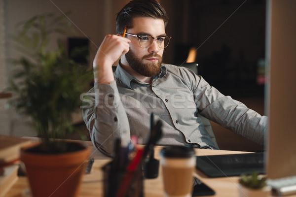 Fiatal szakállas háló designer dolgozik késő Stock fotó © deandrobot