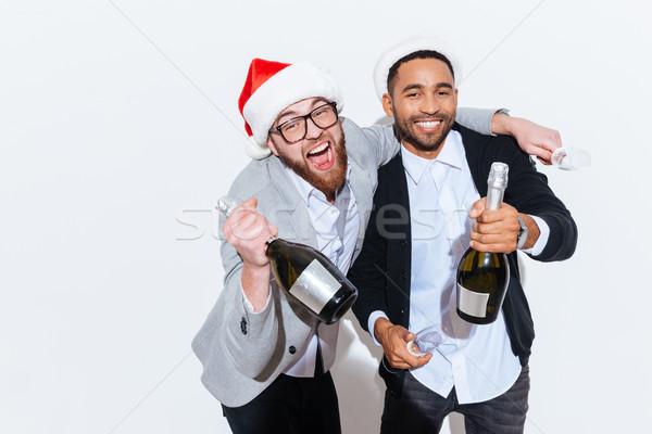 Deux hommes champagne célébrer nouvelle année Photo stock © deandrobot