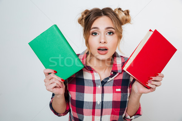 Young Woman in shirt choosing between the books Stock photo © deandrobot