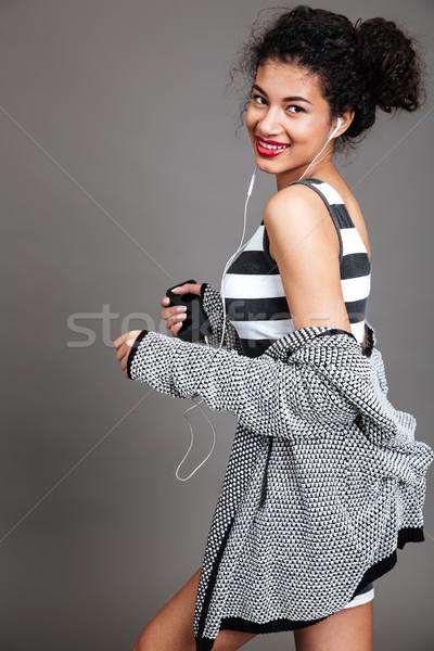 современных молодые африканских женщину ходьбе мобильного телефона Сток-фото © deandrobot