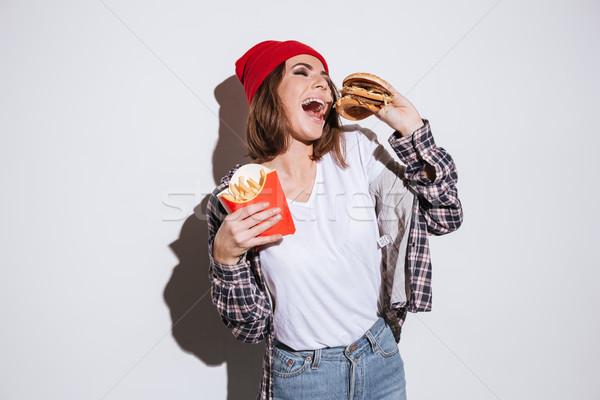Hongerig dame frietjes hamburger afbeelding Stockfoto © deandrobot