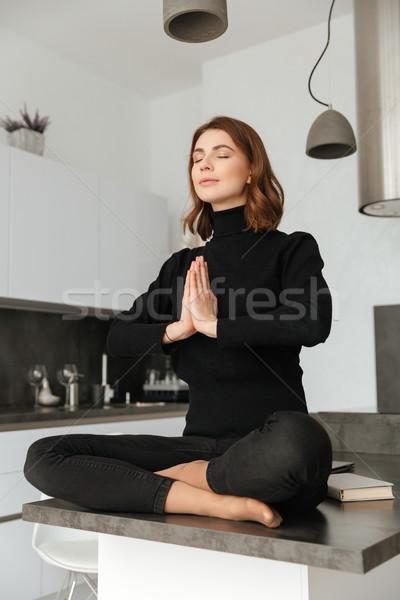 şaşırtıcı kadın siyah kazak yoga Stok fotoğraf © deandrobot