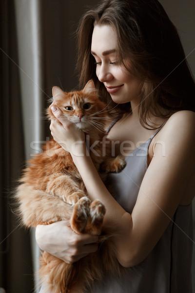 Vertical image of woman in nightie with cat Stock photo © deandrobot
