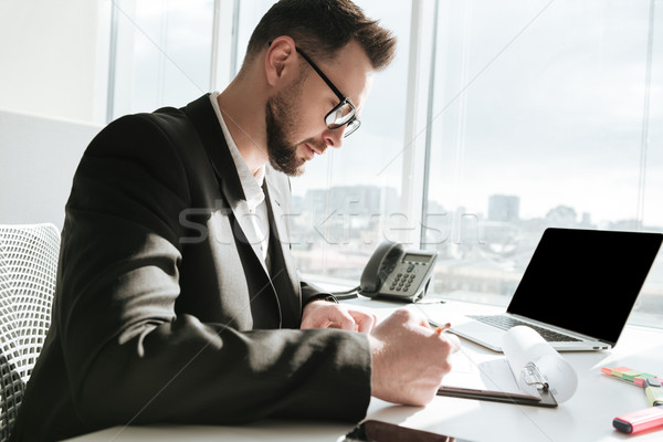 Side view of Business man by the table Stock photo © deandrobot