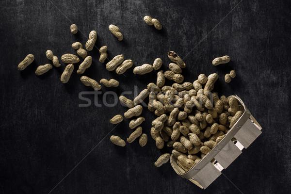 Top afbeelding gedroogd pinda's donkere Stockfoto © deandrobot
